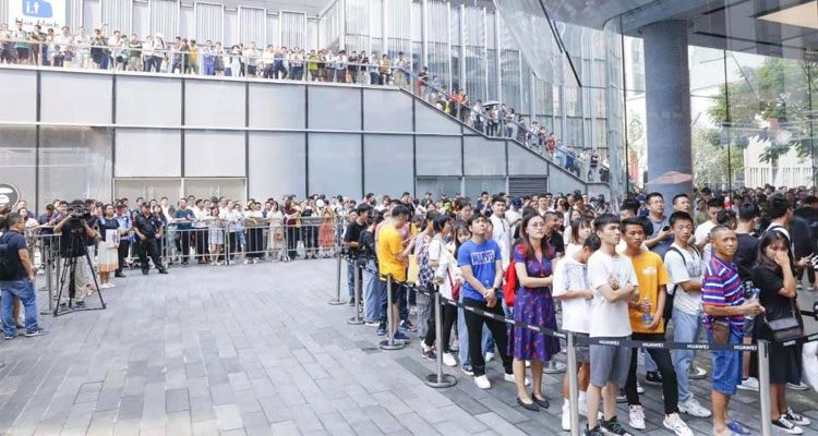 Long lines outside Huawei's flagship store in Nanshan district of Shenzhen as fans are waiting to purchase the company's latest flagship.